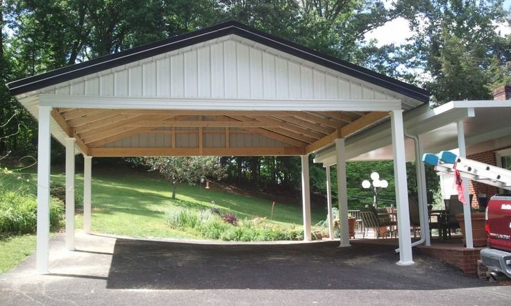 Gallactically pleasant carport design pictures from different vary : Spacious Wooden And Metal Open Garage For About Two Cars With Unpainted Ceiling And Black Roof Beside The Terrace Of The House