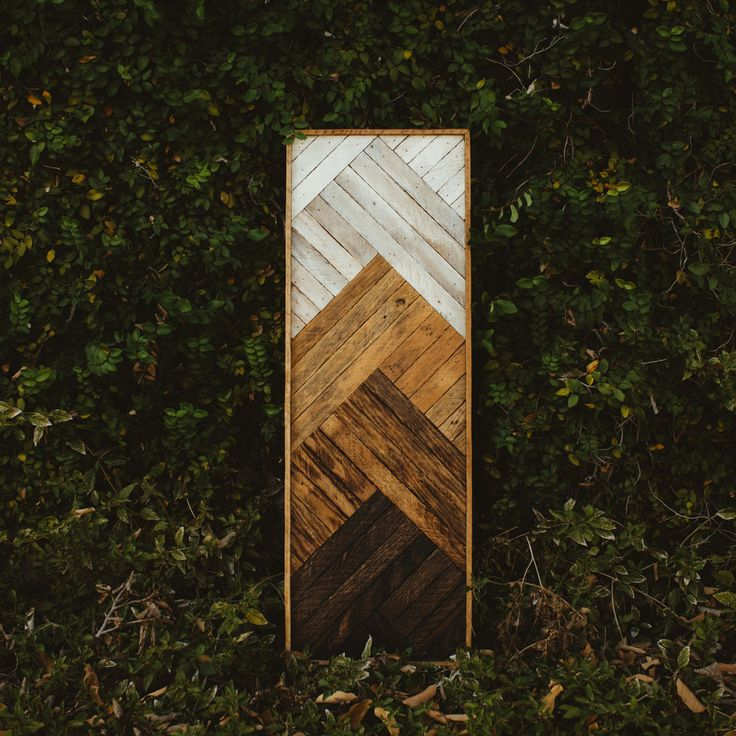 """Meet Monroe, a horizontal piece featuring our own take on a gradual ombré effect.  Various stages of charred and whitewashed woods create the piece's layered, angular look.  36"""" x 12"""""""