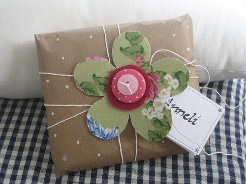 paper bag, twine, and scraps for wrapping