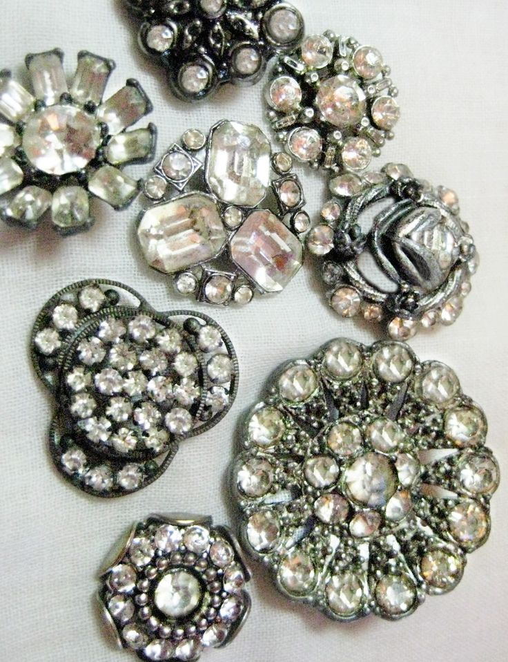 Vintage glass rhinestone and silver metal buttons...be still my heart!