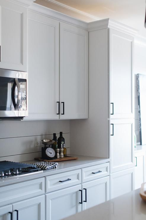 White Shaker Kitchen Cabinets Accented With Oil Rubbed Bronze Pulls
