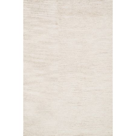 Anchor your living room seating group or define space in the den with this stylish rug, showcasing an ivory hue.      Product: Rug