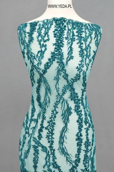 Koronka 10554 SEA Doskonała na suknie koktajlowe lub wieczorowe. Idealna dla druhen, świetnie prezentuje się na przyjęciach weselnych,studniówkach lub balach sylwestrowych.