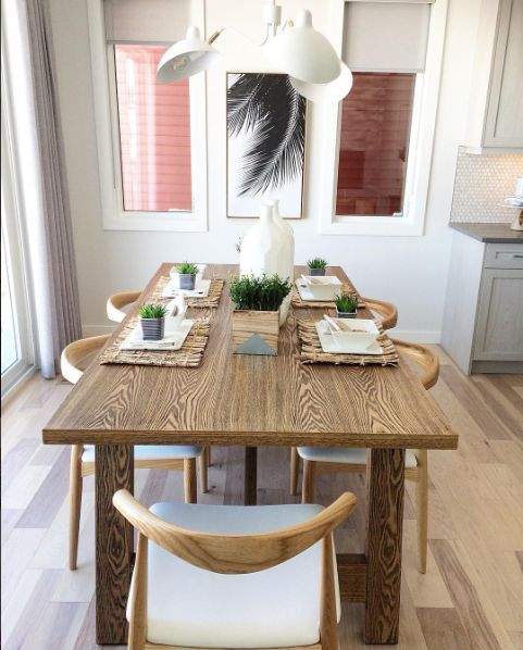 This beautiful dining room features our Persia light Hickory hardwood floor. This beautiful floor from our Émira series features our Pure Genius air-purifying technology. Photos taken in on of Homes by Avi show home, decorated by Show Home Girls. #artfromnature