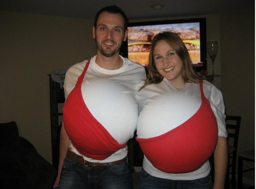 """""""The Girls."""" The picture pretty much says it all. You'll definitely be the center of attention in this costume. Needed: White t-shirts, large bouncy balls, red fabric and fabric glue.#halloween #couplescostumes"""