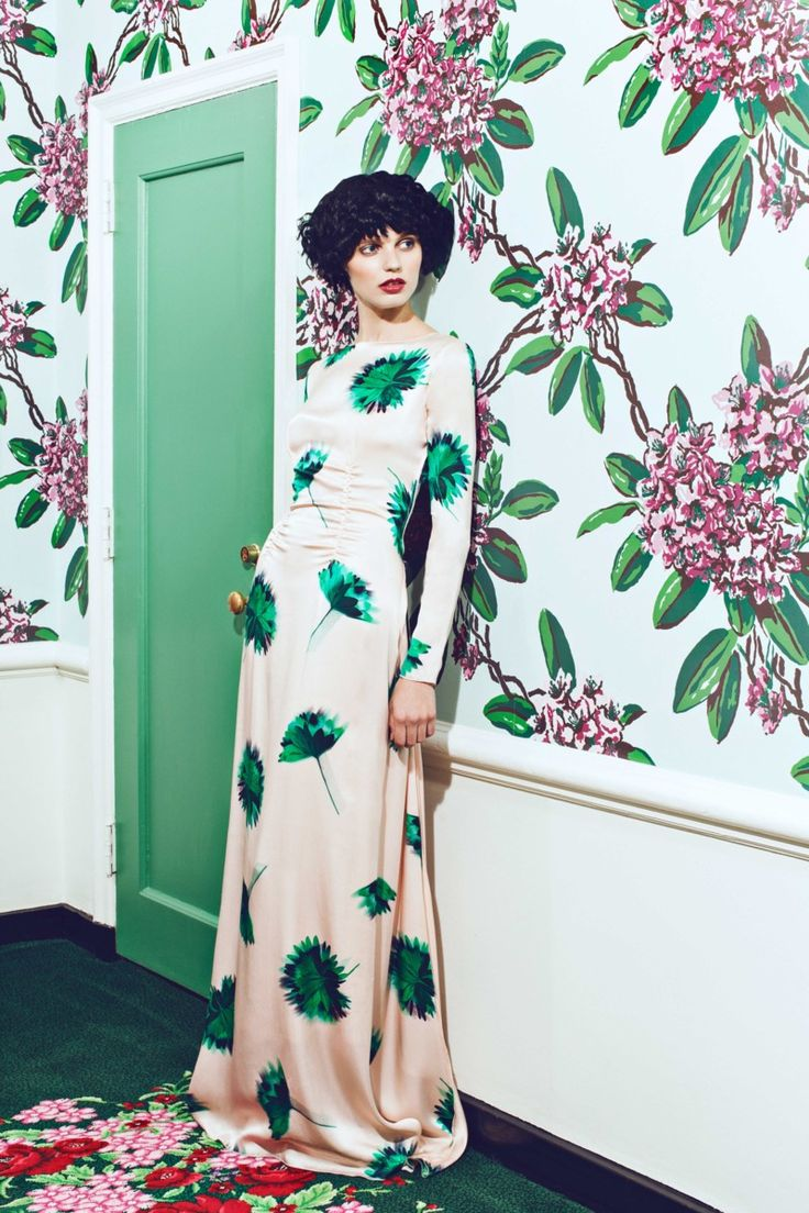 Nina Ricci floral gown with floral wallpaper