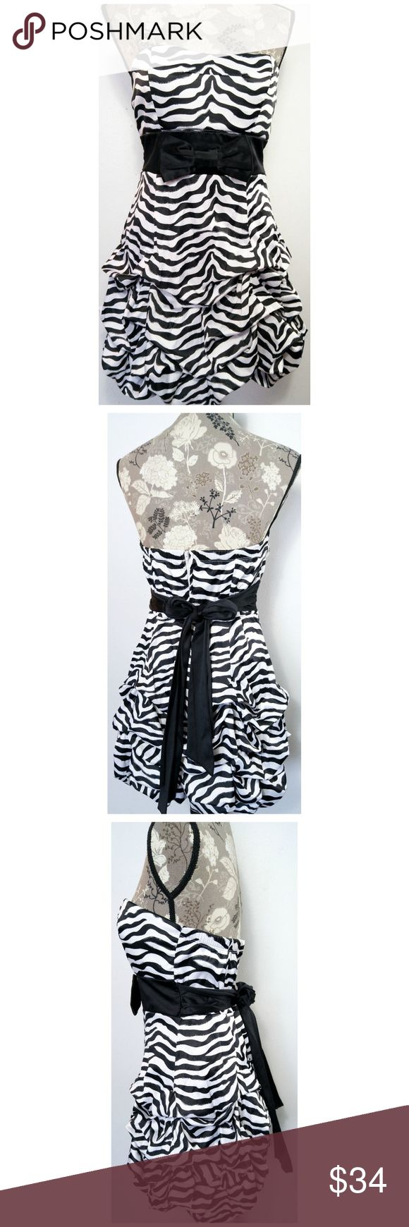"""Ruby Rox Dress Size 9 Zebra Stripes Strapless Prom Bust is lightly padded, Back zipper, ties at the waist, Skirt has the puckered balloon look. Dress is fully lined.  Across Bust 17"""" Waist 15"""" Across Length 28"""" from center back From a smoke-free home Excellent Condition, No rips, tears, or stains. (254) Ruby Rox Dresses"""