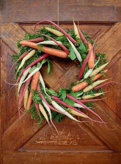 How to make a veggie wreath. Looks like a great decoration for something festive at the barn. Bonus: you can feed it to your horse afterwards! (Just make sure you've taken out any wires)