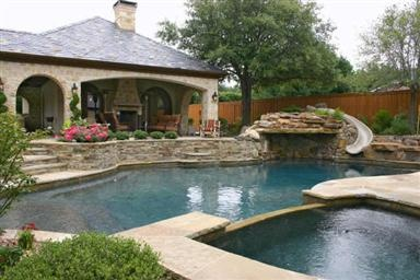 pool with slide and waterfall