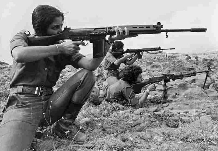 """Christian Lebanese women, members of Kataeb Phalangist party, train with weapons on Sept. 9, 1976. The Lebanese civil war erupted a year earlier. (""""A Brief History Of Women In Combat"""", The Picture Show, NPR)"""