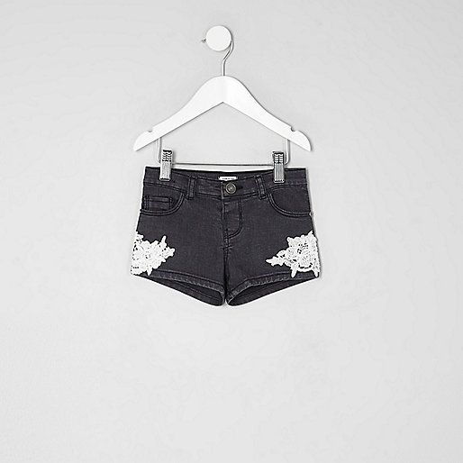 Washed black denim Crochet applique detail Belt loops Five pockets