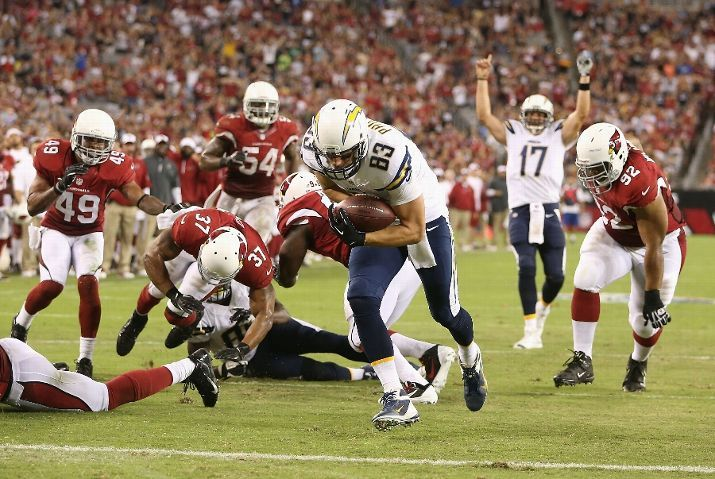 Tight end John Phillips #83 of the San Diego Chargers scores a 3 yard second quarter touchdown on a fumble recovery against the Arizona Cardinals during the preseason NFL game at the University of Phoenix Stadium on August 24, 2013 in Glendale, Arizona. (Photo by Christian Petersen/Getty Images)