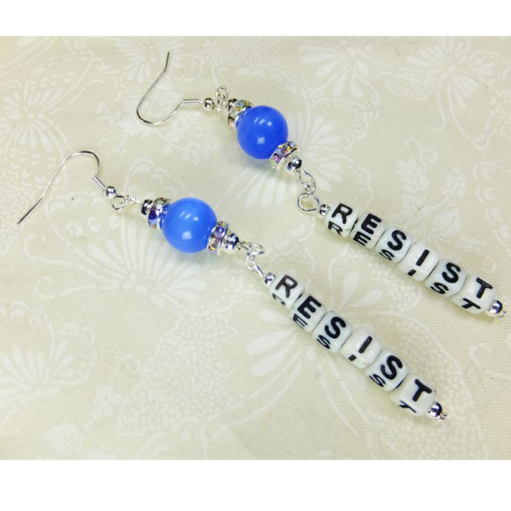 Get RESIST earrings today at my #etsy shop: Blue beaded RESIST Verticle Dangle Earrings Handcrafted with Black and White Acrylic Letter Beads and Blue Catseye Glass Beads http://etsy.me/2EJWV18 #jewelry #earrings #blue #FantasyCreations1 #women #patriotic