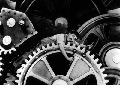 Charlie Chaplin in Modern Times, one of the most famous movie scenes ever.