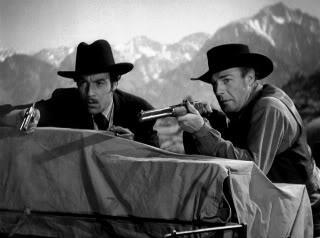 Cesar Romero as Doc Holliday and Randolph Scott as Wyatt Earp in Frontier Marshal, 1939 (dir:  Allan Dwan)