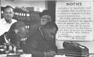 """Registering to vote in Hattiesburg, MS. The sign on the wall informs applicants that their names will be printed in the local paper for two weeks following their application.  Thus, local employers, landlords, police officers, and other whites had time to """"convince"""" prospective voters to withdraw their registration."""