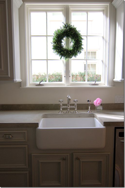 A kitchen must: casement windows, farm sink, and polished nickel faucet – perfection!