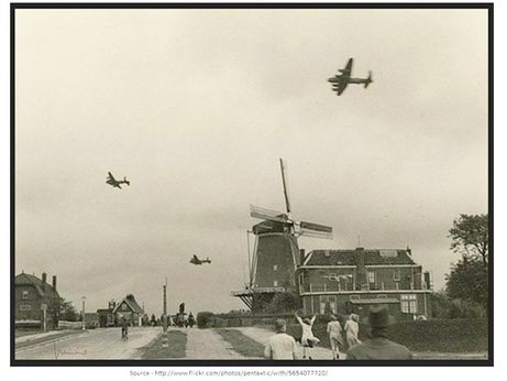 """During Operation Manna, the bomber pilots had to fly extremely low to drop the food parcels over Holland to the starving Dutch people. One Canadian pilot recalled flying by a windmill and people waving from its balcony. """"You understand, we had to look up to wave back!"""""""