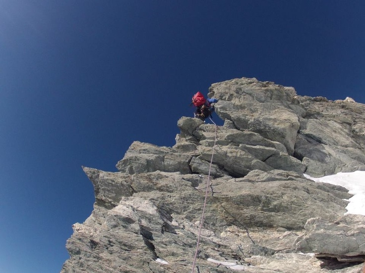 Climbing a wall on Weisshorn