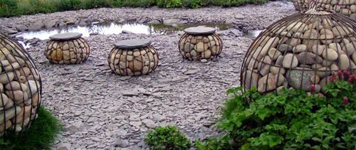 Gabion spheres as seats? ~  wire mesh cages filled with stones. Okay, so I never sit down and rest while I'm in the garden but they would be a fun landscape element.