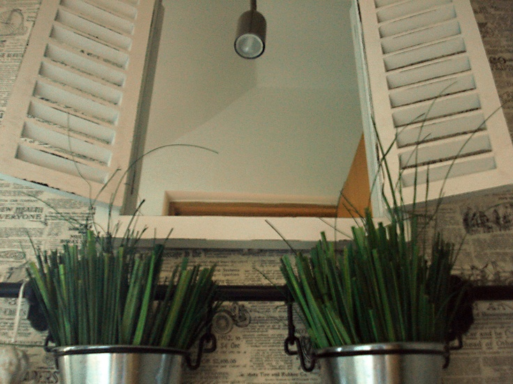 French look in a bathroom: window like mirror and plant pots