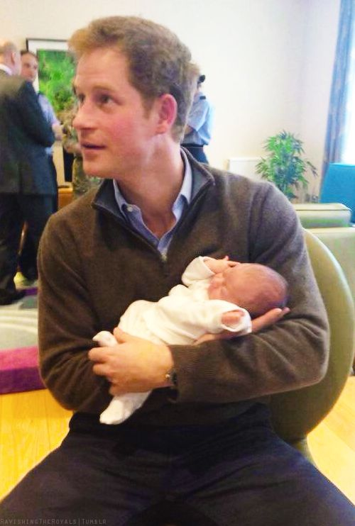 Prince Harry destroying our sanity snuggling a newborn. ❤️