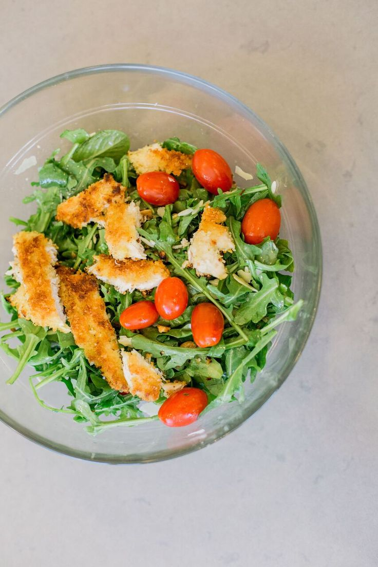 Ready to eat Taylor Farms lemon arugula salad with my recipe for panko crusted chicken - flatlay image - tomatoes - healthy recipe - dinner ideas - wellness - food