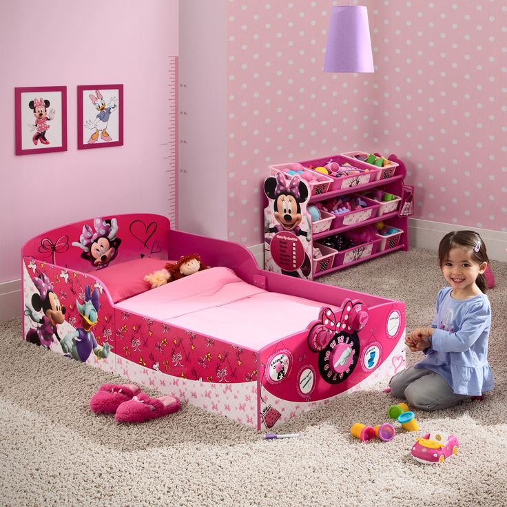 What will your little one love most about this Minnie Interactive Wood Toddler Bed from Delta Children? Will it be the colorful Disney graphics that inspire any mini mouseketeer? Or will it be the bef