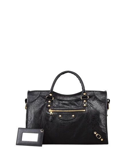 """Balenciaga City bag in black soft lambskin with golden hardware, including stud and buckle detail. Tote handles with 4"""" drop; removable shoulder strap with 9"""" drop. Zip top. Exterior zip pocket. Black"""