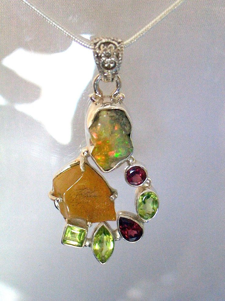 A Festival of Natural Gemstones: Fire OPAL Rough, AMBER Rough, PERIDOT and…