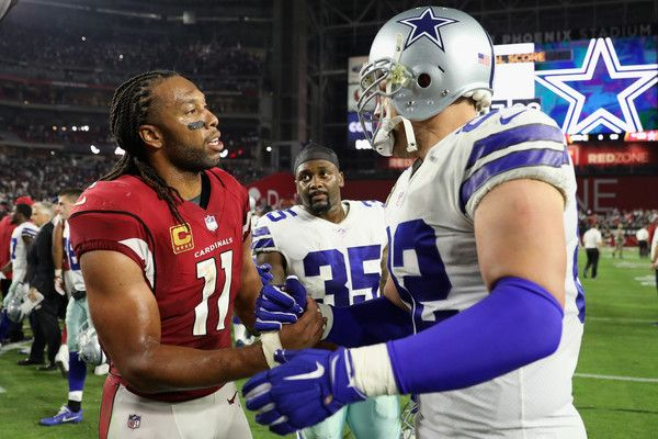 Jason Witten Photos - Wide receiver Larry Fitzgerald #11 of the Arizona Cardinals and rtight end Jason Witten #82 of the Dallas Cowboys shake hands after the NFL game at the University of Phoenix Stadium on September 25, 2017 in Glendale, Arizona. The Coyboys defeated the Cardinals 28-17. - Dallas Cowboys vArizona Cardinals