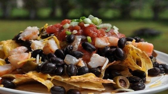 Say goodbye to the same old nachos. Want to try a crowd favorite that is sure to be a hit on game day? These spicy shrimp and black bean nachos are filling and tasty. Plus, make an extra helping of these black beans to have with rice or as a side dish the next day.