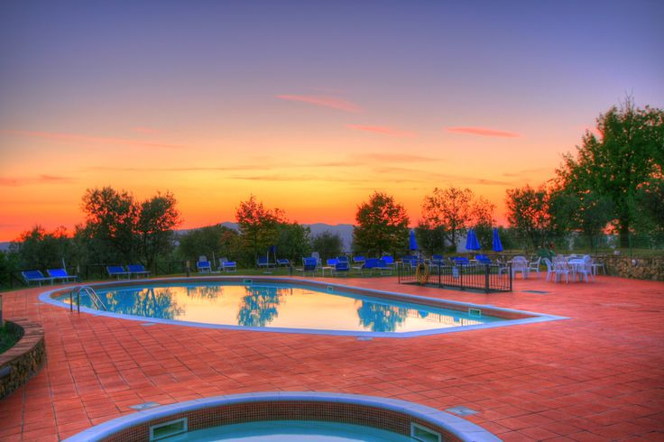 Sunset over the pool at Villa Rioddi in Tuscany. http://bit.ly/1gyZkhK