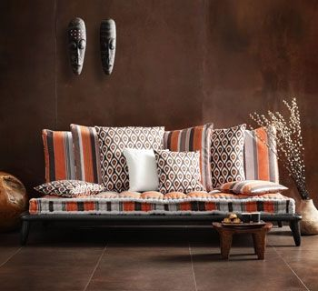 Super fresh, modern African blend in this seating area.  Love the patterns.