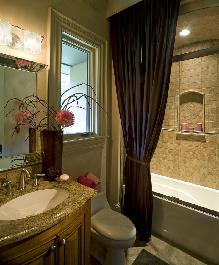 recessed lighting over shower. we love the color scheme in this bathroom a purple shower curtain surrounds glass recessed lighting over b