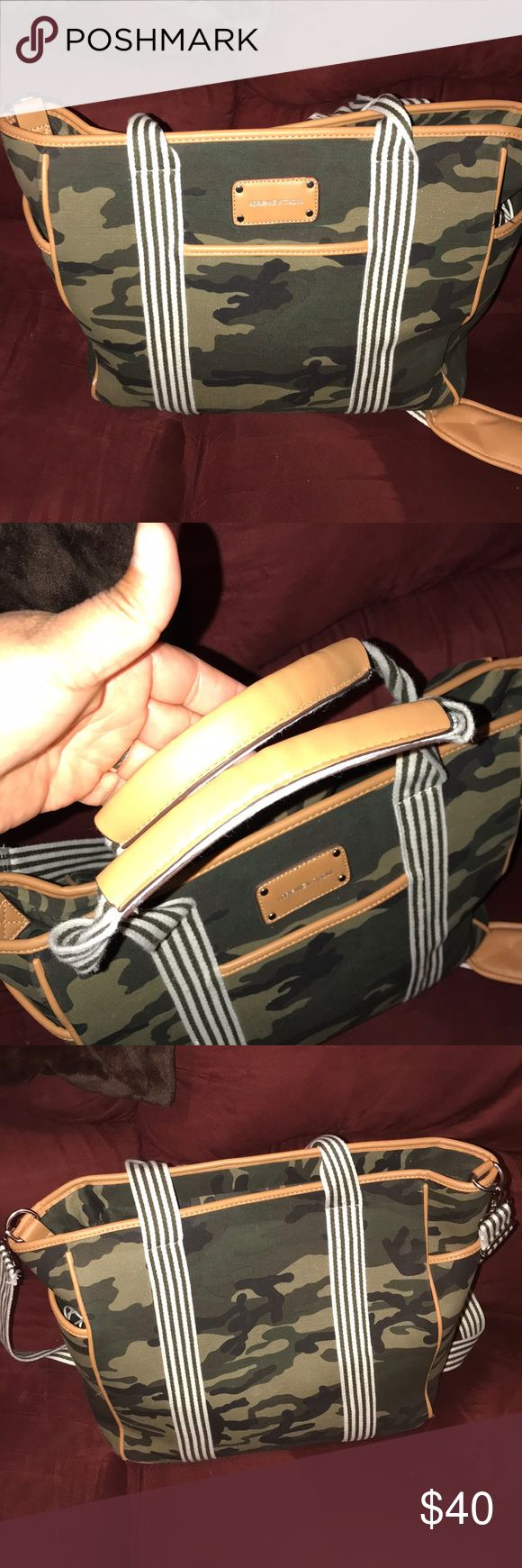 Luggage bag Very large luggage bag. Camouflage in like new condition. Was using as a laptop bag. Side compartments. Tote straps and long shoulder strap Adrienne Vittadini Bags Travel Bags