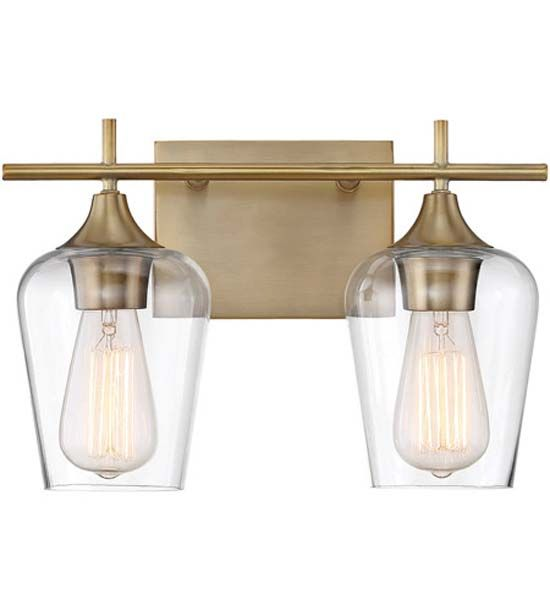 $90 Octave Bathroom Vanity Light. It features large curved shades of Clear glass, minimal detailing and a Polished Chrome, Warm Brass, or English Bronze finish. Available in 2, 3, and 4 light options. May be mounted up or down. 100 watt, 120 volt Edison A-Shape Medium base incandescent bulbs are required, but not included. UL listed for damp locations. 2 Light: 13.75 inch width x 9 inch height x 5.5 inch depth. 3 Light: 21 inch width x 9 inch height x 5.5 inch depth. 4 Li...