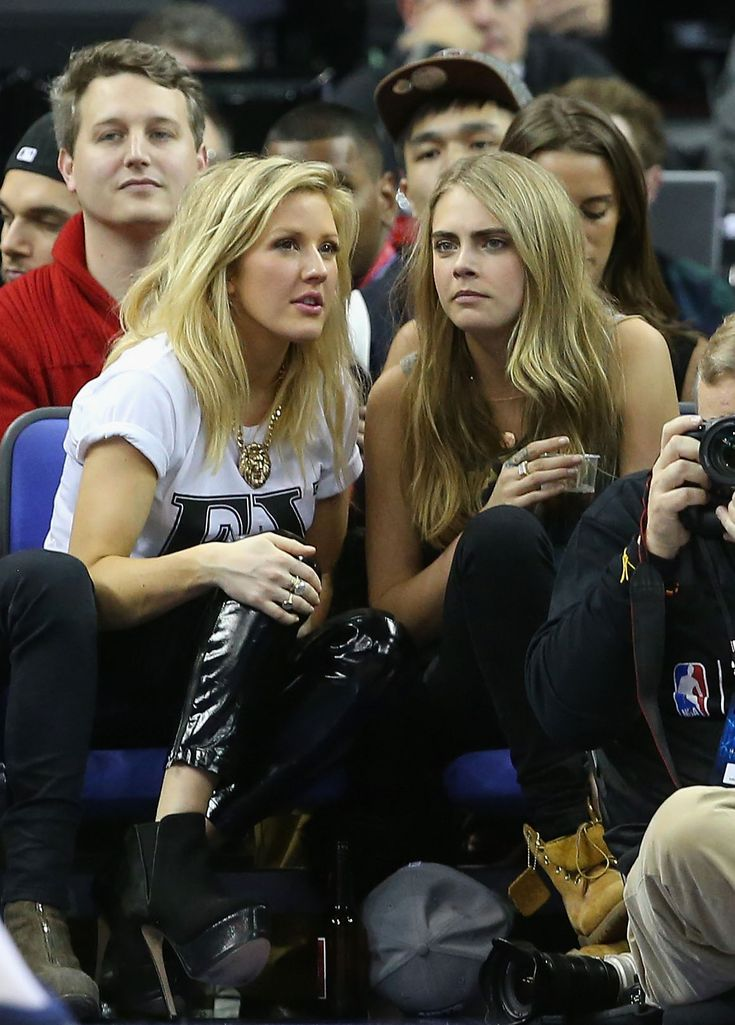 LONDON, ENGLAND - JANUARY 16:  Model Cara Delevingne and Ellie Goulding attend the Eastern Conference NBA match between Brooklyn Nets and Atlanta Hawks at O2 Arena on January 16, 2014 in London, England.  (Photo by Julian Finney/Getty Images)
