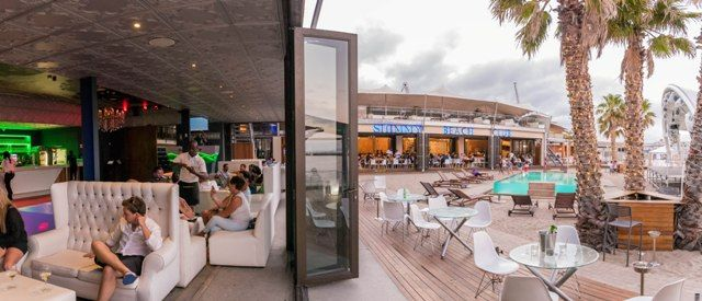 The Lounge Club at Shimmy Beach Club with ocean views, leading out onto the private beach and Heineken Deck