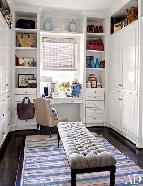 A custom-made bench by Erinn V. Maison rests on an antique dhurrie in the master suite's dressing area.