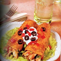 Body for Life Chicken Enchiladas...if you have trouble finding green enchilada sauce it's ok to use regular. Whenever I make these, I NEVER have leftovers. Delicious and low-fat. Bill Phillips (awesome guy who came up with Body for Life) said his mom came up with this recipe and it's his FAVORITE