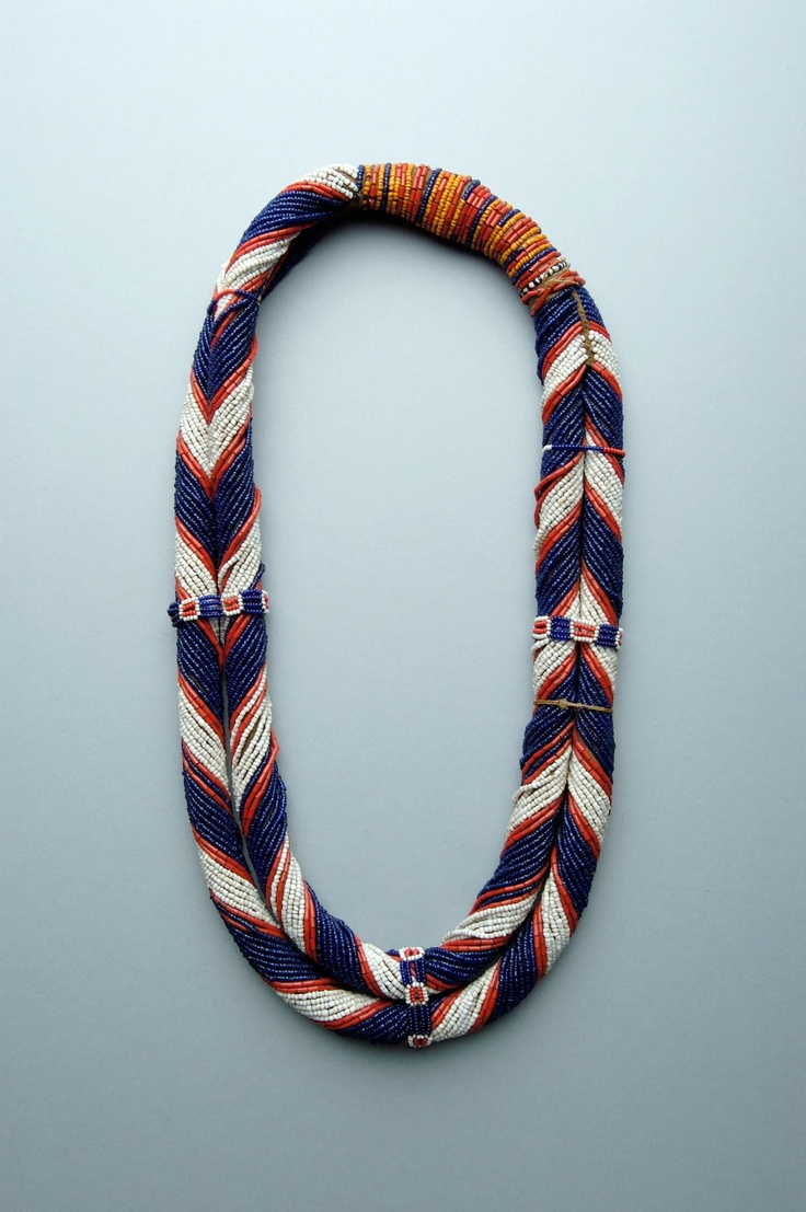 A beautiful necklace of two strands, i.e. rolls covered with glass beads of several colours, and tied together at the top. Nagaland (India): Konyak Naga people; mid 20th c or before.