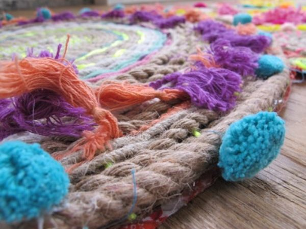 Round Rug- Use large Hula Hup as frame. Make different sizes. Sew together to form as large of rug as desired.
