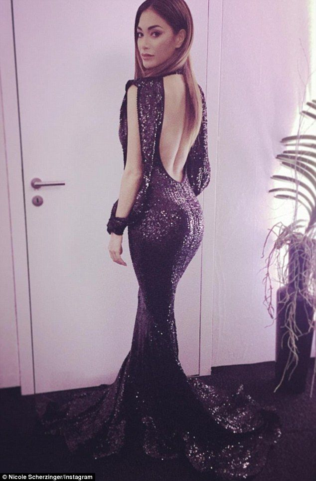 No harm no foal! Flashing the flesh with a racy backless cut out, the Right There hitmaker drew attention to her pert posterior that clung to the glittering sequinned fabric