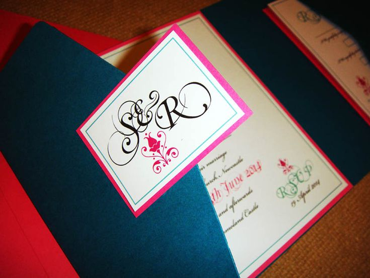 Teal pocketfold envelope matched with pink backing card and topped with a crisp white insert. Ideal for a fresh spring/summer wedding!  www.justaddyou.ie