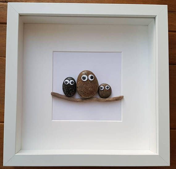 A beautiful and unique pebble art picture of rock and roll concert, 5 rocks with googly eyes holding a sign with text of your choice. Or family of pebbles with googly eyes with wording underneath picture if required. Please let me know which you would like. This picture compliments any