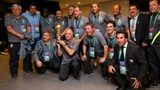 Luiz Felipe Scolari head coach of Brazil holds the FIFA Confederations Cup trophy and poses with the Brazilian coaching staff members - FIFA.com