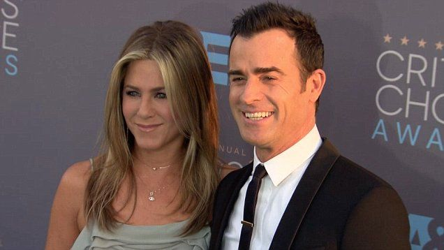 Jennifer Aniston and husband Justin Theroux walked the red carpet together at the 2016 Critics' Choice Awards.  The Hollywood couple walked arm and arm as they smiled for photographers.