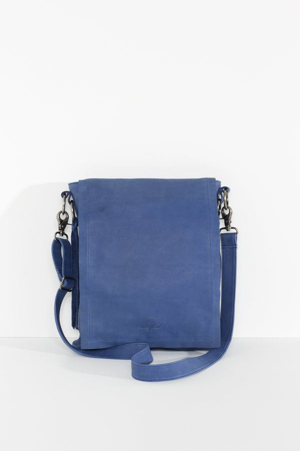 A slimline cross body satchel with delightful tassel details and long front flap for extra security.  secure magnetic fastener long tassel...