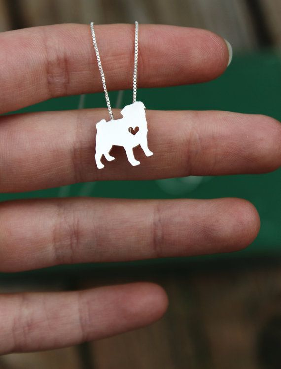 "This tiny Pug necklace is a perfectly delicate way to keep a loved pet close to your heart. Just ⅝"" at its largest dimension, our pendants are made by hand with love.  This pendant is cut, soldered, finished, and polished completely by hand. It comes with a delicate sterling silver box chain, and is packaged in a gift box. If you are purchasing this item as a gift and would like a short note included, please add your text in the note to seller at checkout…"